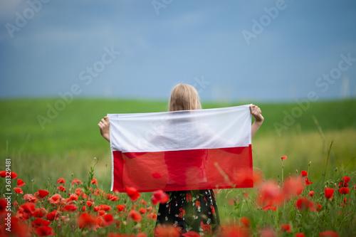 Wallpaper Mural Blond girl holding flag of Poland in the poppy field