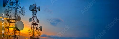 Telecommunication towers with wireless antennas on sunset sky Fototapet
