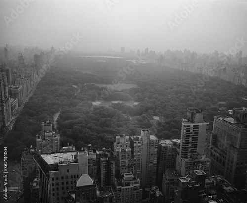 Leinwand Poster Misty foggy morning New York Cityscape view onto Central Park South looking nort