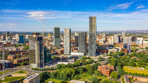 Canvas Print Aerial shot of Manchester UK on a beautiful summer day during pandemic lock-down