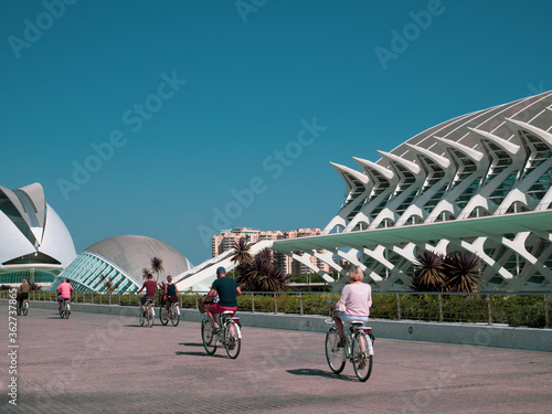 People Riding Bicycles Against Clear Blue Sky