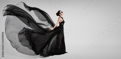 Fotografia, Obraz Portrait of a mysterious girl in a black flying dress