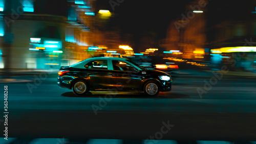 Canvas Print Car On City Street At Night