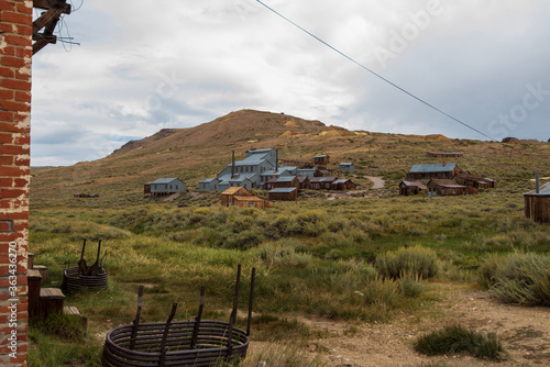 Wallpaper Mural Houses And Buildings Of Ghost Town On Hillside On Field Against Sky