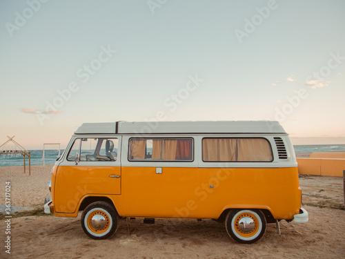 Obraz na plátně Vintage Van At Beach Against Sky During Sunset