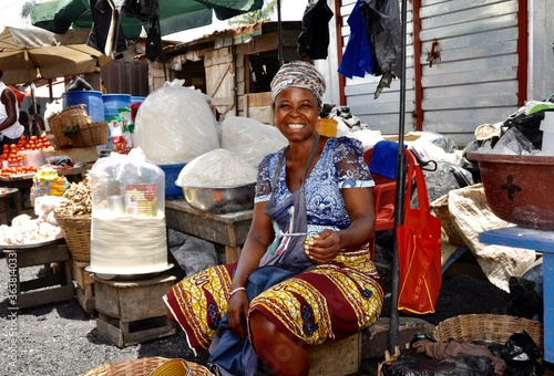Portrait Of Woman Sitting At Market Stall Fototapeta
