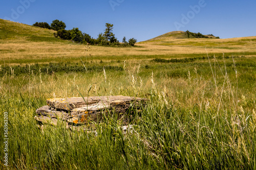 Canvas Print Old Foundation stones mark the spot of a building in the North Dakota hills at Fort Lincoln near Bismarck