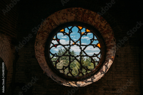 Fotografie, Obraz Round stained glass window in old abandoned castle