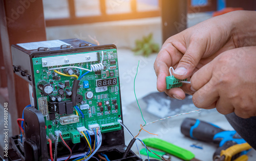 A Technician assembling motor  system and testing motor automatic gate home security system Fototapete