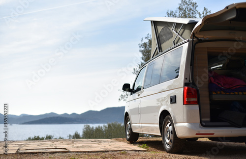 Tela camper van is stand on camping place on sea coast