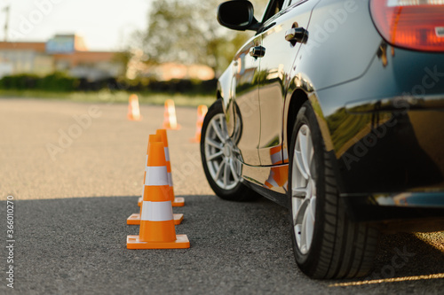 Photo Car and traffic cones, driving school concept