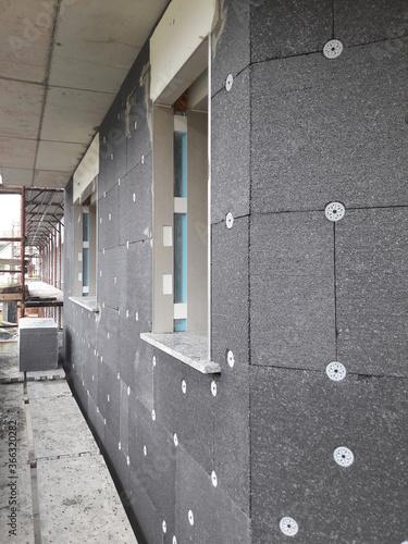 Fotografie, Tablou Sistema di isolamento termico ed acustico delle pareti di facciata delle casa -