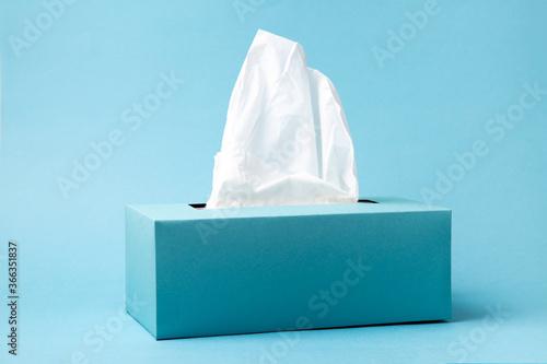 Fotografia Blue tissue box on a blue background