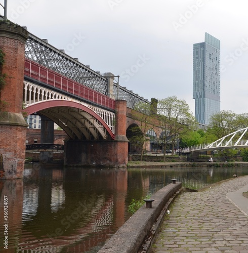 Fotografering Manchester Ship Canal with arched bridge and Beetham Tower, Manchester, UK