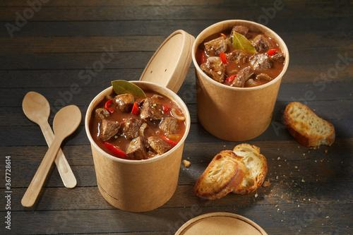 Obraz na plátně Two unlabelled takeaway tubs of rich beef goulash