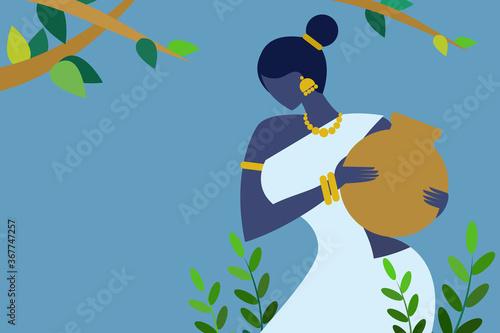Fotografia Indian village woman carrying water pot