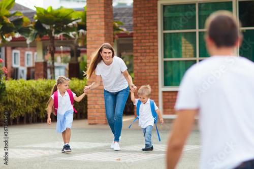 School pick up. Mother and kids after school. Fototapeta