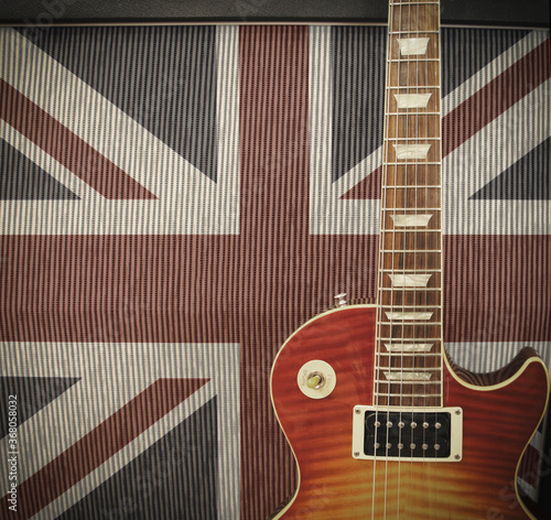 Wallpaper Mural British Rock Invasion concept - detail close up of a guitar leaning against an a