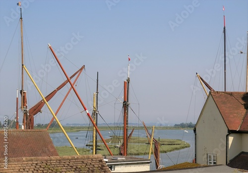 фотография A view across the Thames Barges on Hythe Quay to the Blackwater Estuary at Maldon, Essex, UK