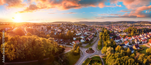 Slika na platnu Aerial panorama of a European town at sunrise, with magnificent colorful sky and