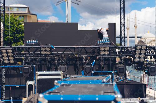 Leinwand Poster lighting and Led panel technician iinstalling professional lighting equipment fo