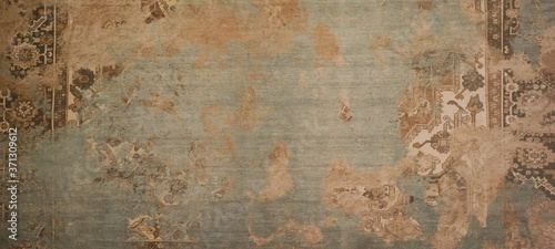 Old brown gray rusty vintage worn shabby patchwork motif tiles stone concrete cement wall texture background banner