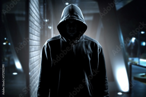Canvas Print Thief in black clothes on room background