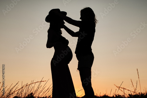 Canvas Print Mesmerizing shot of a lovely pregnant couple - lesbian family concept