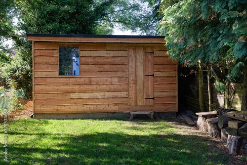Fotografía Waney edge wooden rustic garden shed.