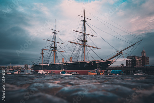 Canvas Print HMS Warrior Birthed in Portsmouth Harbour shot from a low angle