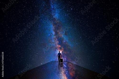 Obraz na plátně Man walking through the universe