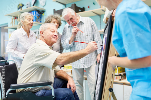 Leinwand Poster Group of seniors with dementia paints together