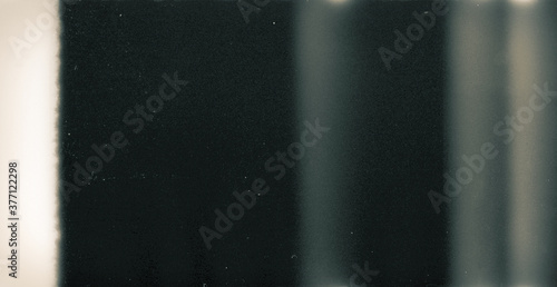 Photo Noisy film frame with heavy noise, dust and grain