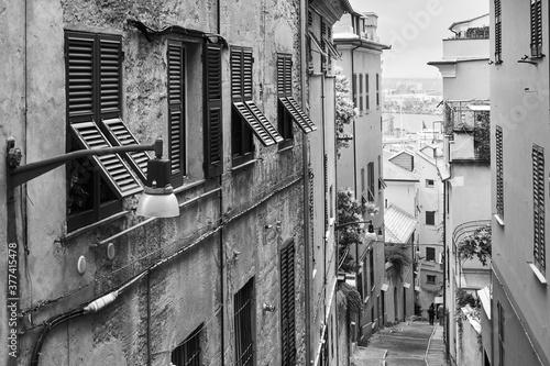 Canvas Print Old downhill street in Genoa