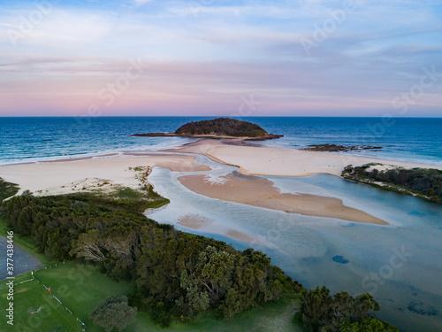 Canvas Print Coastal scene at dusk forest running down to empty sandy beach