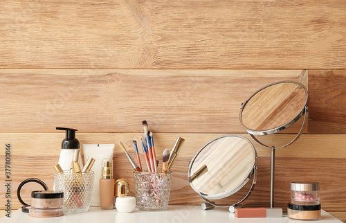Canvastavla Set of decorative cosmetics and mirrors on dressing table