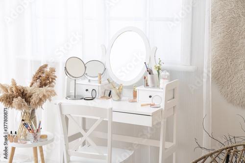 Fotografie, Obraz Set of decorative cosmetics on dressing table in room