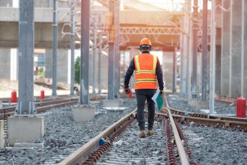 engineer walking and check track work on railways Fototapeta