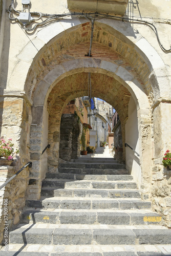 A narrow street among the old houses of San Bartolomeo in Galdo, a small town in the province of Benevento, Italy.