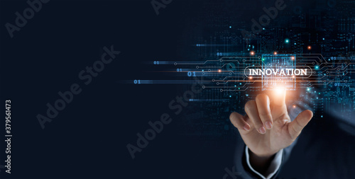 Businessman hand touching virtual graphical interface of innovation. Idea for digital solution and development, intelligence science technology in futuristic global business concept.