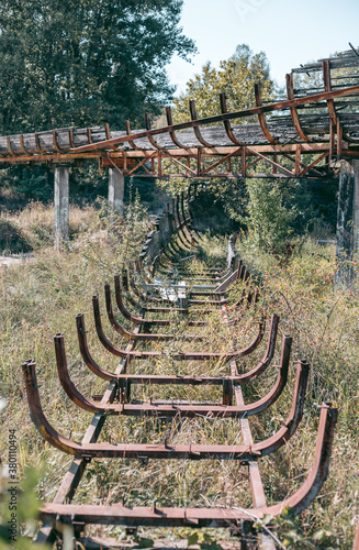 Old abandoned wooden bobsleigh track in summer by daylight Fototapet