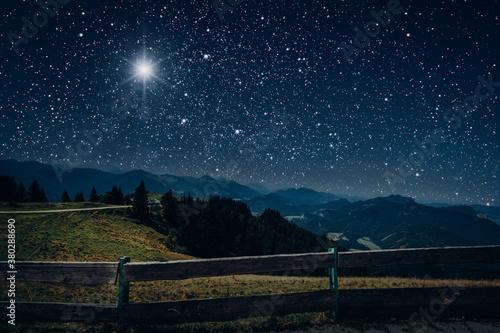 Fotografia, Obraz The moon shines over the manger of christmas of Jesus Christ.