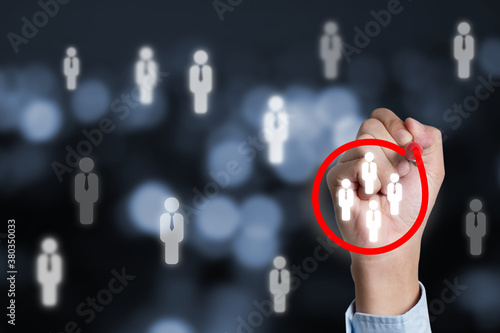 Photo Marketing target audience concept , Businessman writing red circle to mark to focus customer group