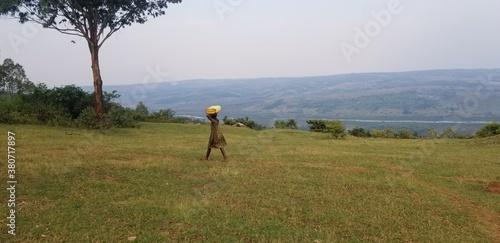 Obraz na płótnie rural girl fetches water downstream