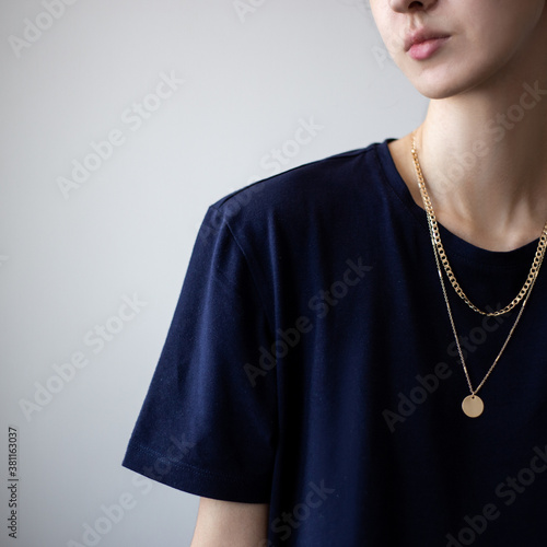Canvas Print Closeup photo of yping woman wearing dark t-shirt and golden necklace