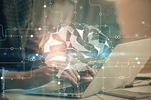 Cuadros en Lienzo Man typing on keyboard background with brain hologram