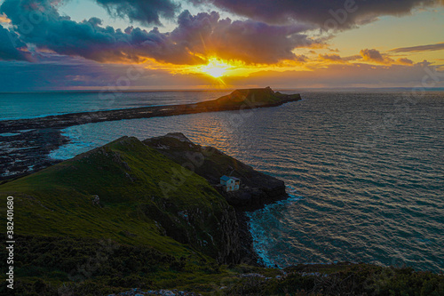 Canvas Print Sunset over Gower Peninsular Rhossilli Bay Worm Rock Formation