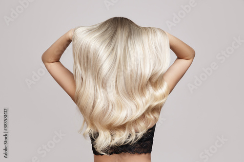 Leinwand Poster wavy blond hair back view