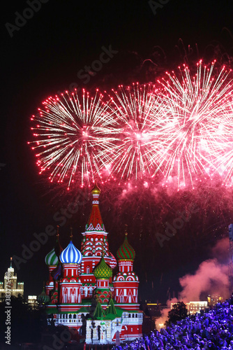 Moscow's famous St Basil's cathedral on Red Square during colorful firework/salut. Russian signature sightseeing place.  #383775418