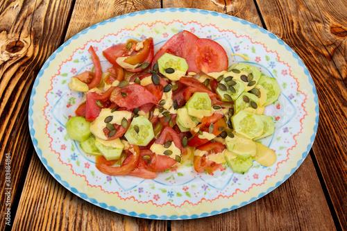 Mediterranean salad with tomato cucumber pumpkin seeds